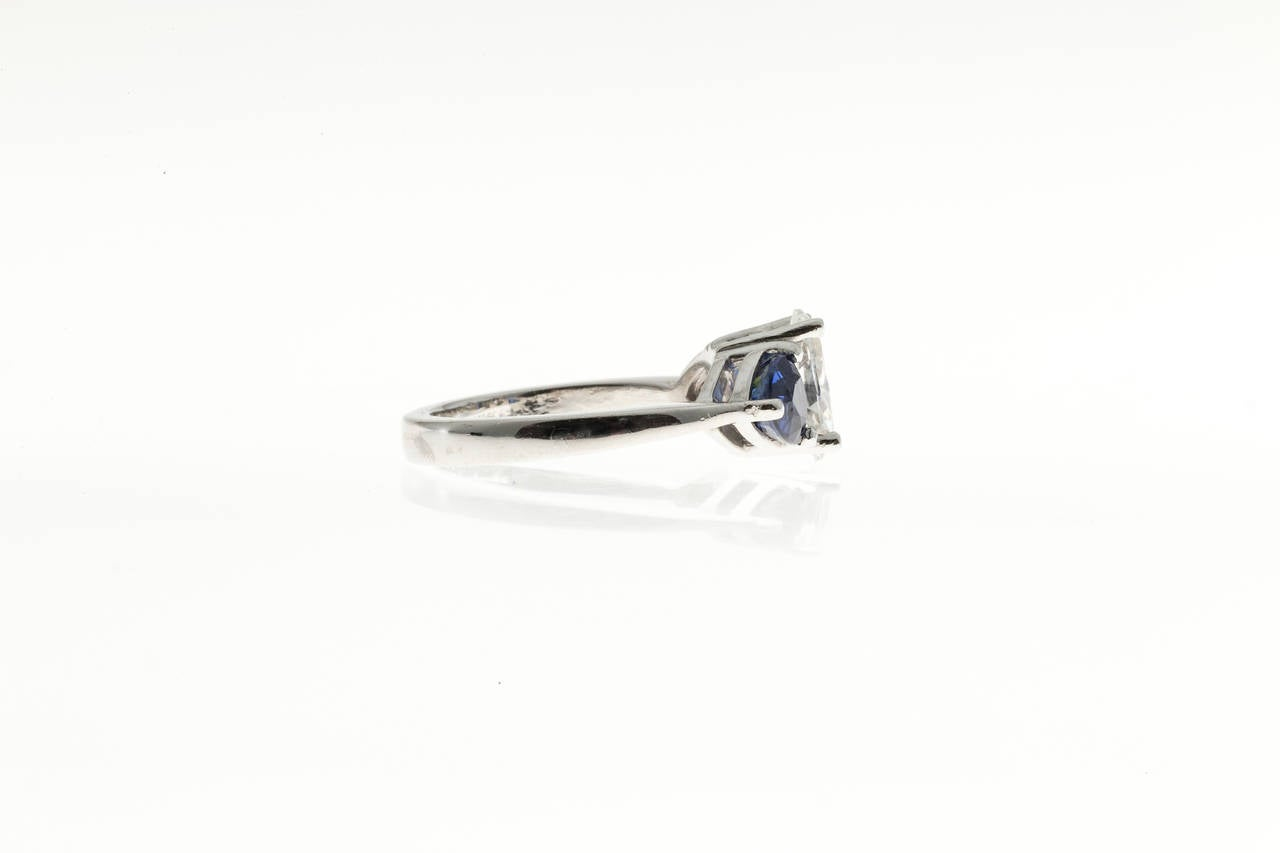 Oval Diamond and Trillion Cut Ceylon Sapphire Platinum Ring 8