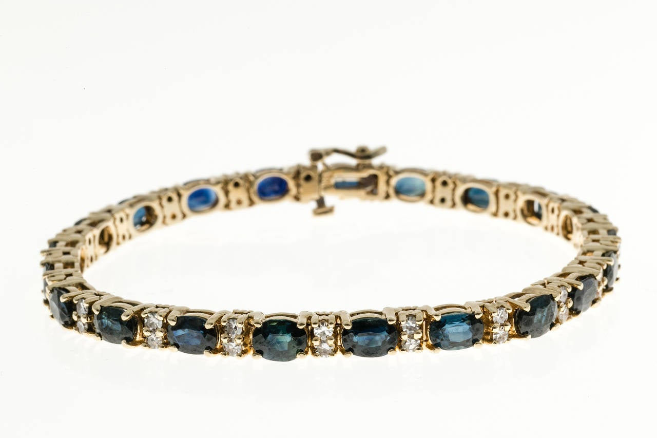 Classic well-made hinged link Royal blue Sapphire diamond tennis bracelet.