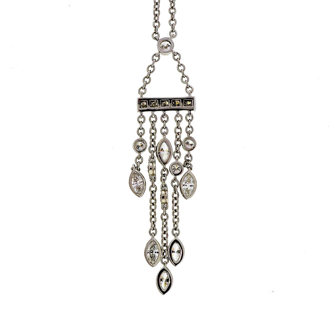 Tiffany & Co Platinum and diamond swing drop pendant necklace.   17 Marquise and round diamonds, approx. total weight .99cts, F, VS Tiffany & Co cable chain: 16 inches plus dangle Platinum 950 7.2 grams Tested: Platinum Stamped: PT 950 Hallmark: