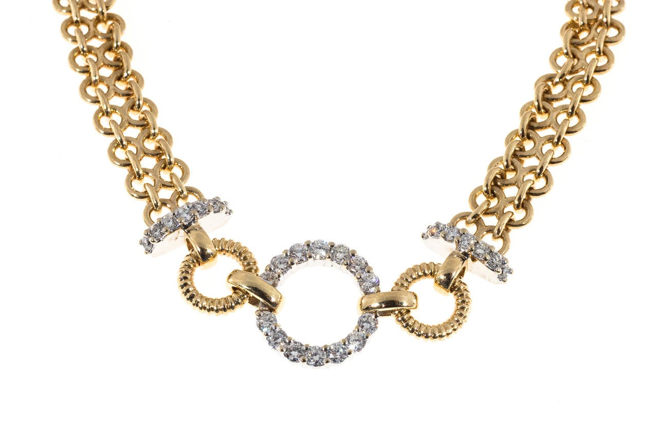 14k yellow gold two row chain link bracelet with white diamond accents.  29 round diamonds approx. total weight .70cts 14k Yellow Gold Stamped 14k   BB The hallmark is BB 14.1 grams Length: 7 inches