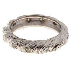 Round Mele Diamond Platinum Swirl Design Ring