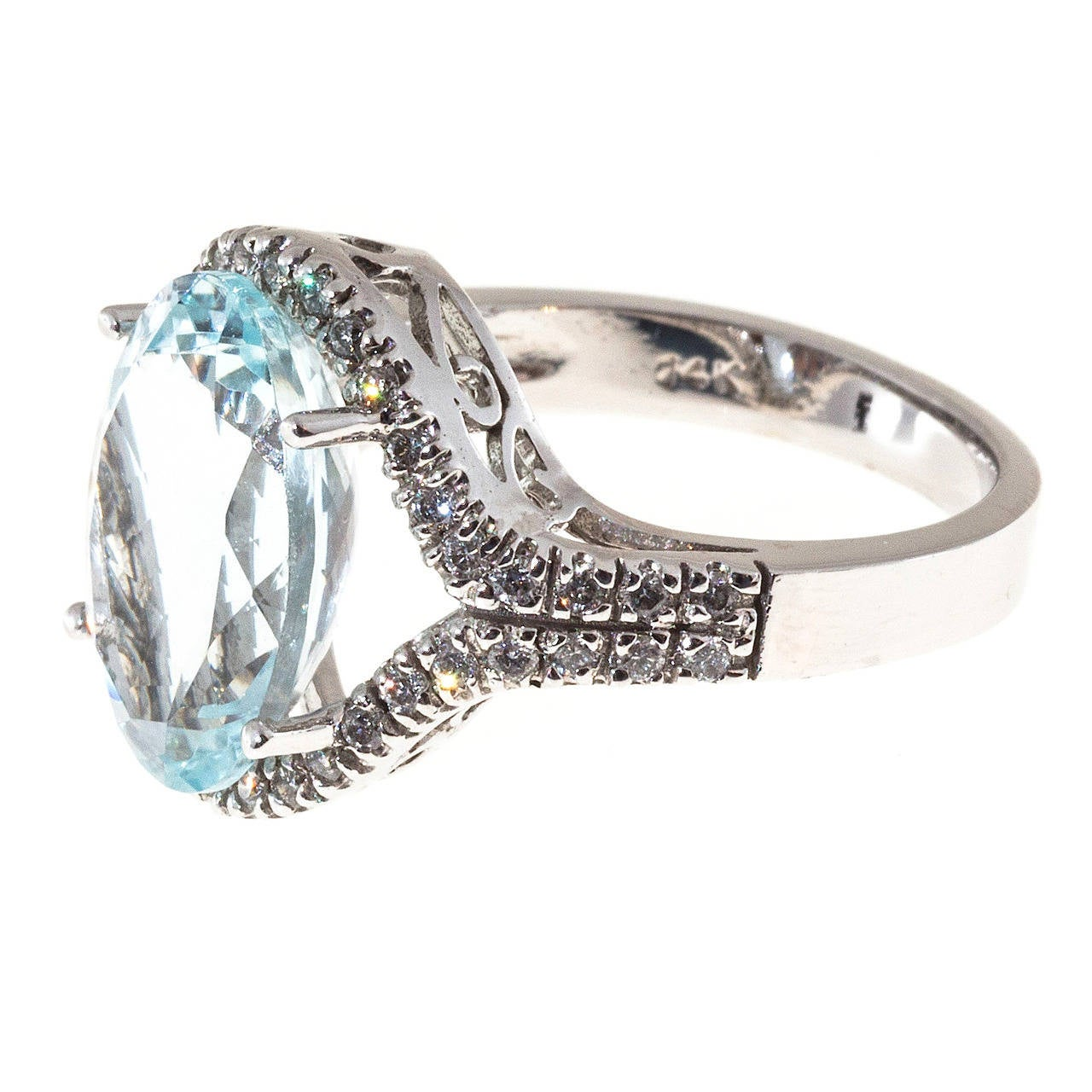 Bright slightly green, medium blue natural oval Aqua in a beautiful simple14k white gold diamond halo ring.  1 oval natural no heat bright light blue oval Aqua 14 x 10mm, approx. total weight 6.75cts 42 full cut diamonds, approx. total weight