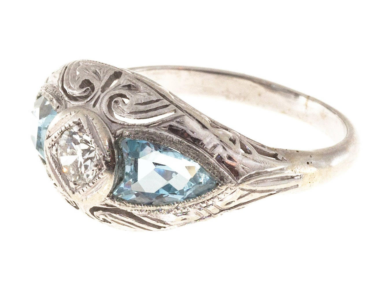 Rare Art Deco 14k white gold pierced ring with shield cut genuine Aqua side stones and a nice center diamond. Shank replaced long ago.