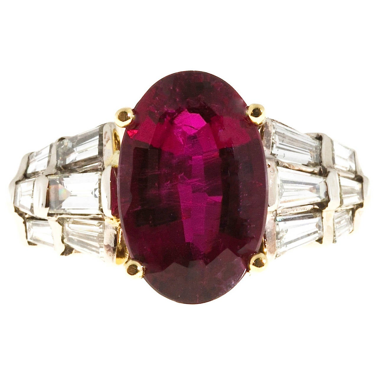 Bright red Rubelite Tourmaline and diamond cocktail engagement ring. Original 1950s 18k and 14k yellow and white gold setting with straight and tapered bright white baguette diamond sides. GIA certified natural Rubelite Tourmaline center stone with