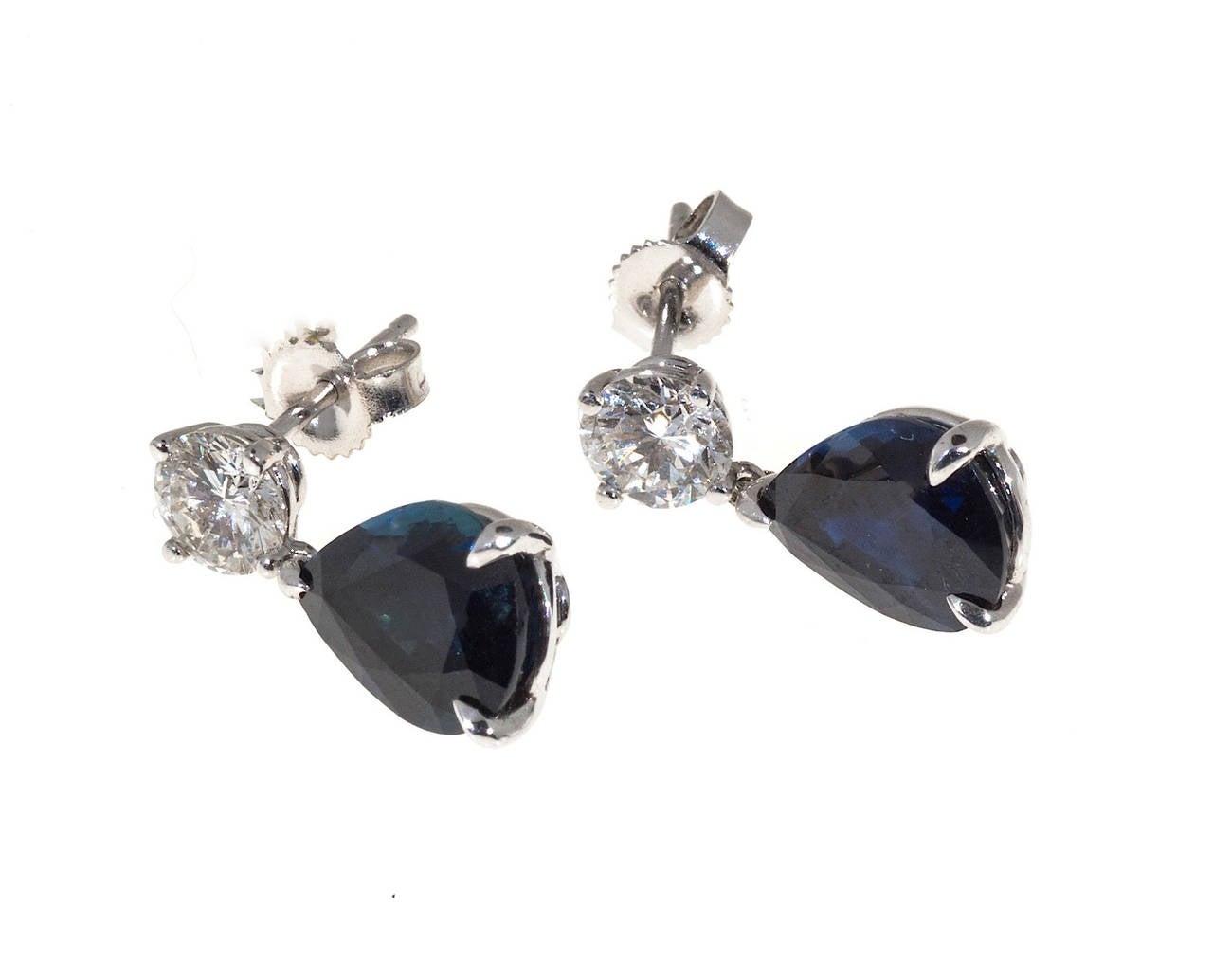 Very fine Royal blue natural color simple low level heat only pear Sapphire dangle earrings with sparkly diamond tops.