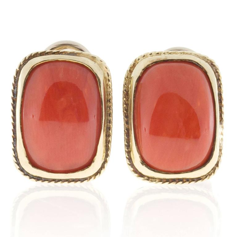 Top gem orange well-polished untreated Coral set in hand made clip post earrings with pierced galleries.  Pierced side gallery and under gallery.