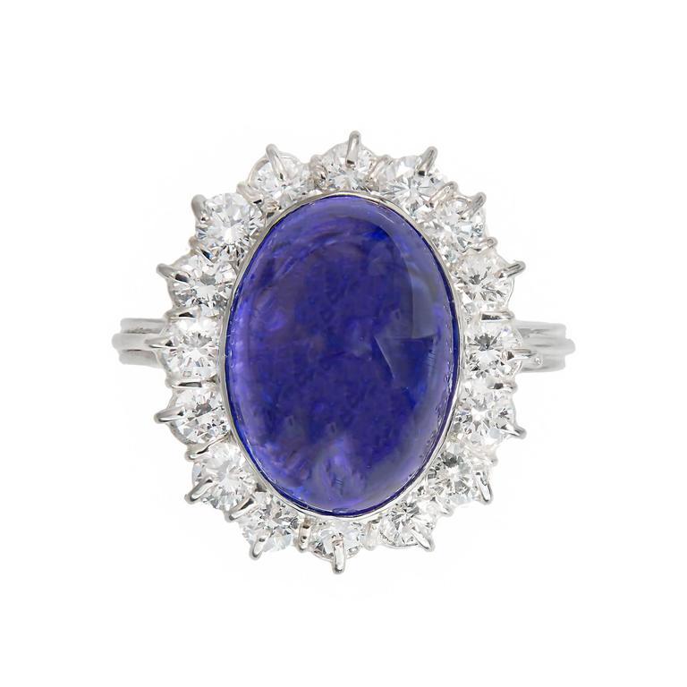 Bright purplish blue cabochon Tanzanite engagement ring approx. 9.75cts in its original 1970s handmade wire setting. The Tanzanite is cut high dome. There are moderate inclusions some of which are eye visible especially from the side.  One-gem