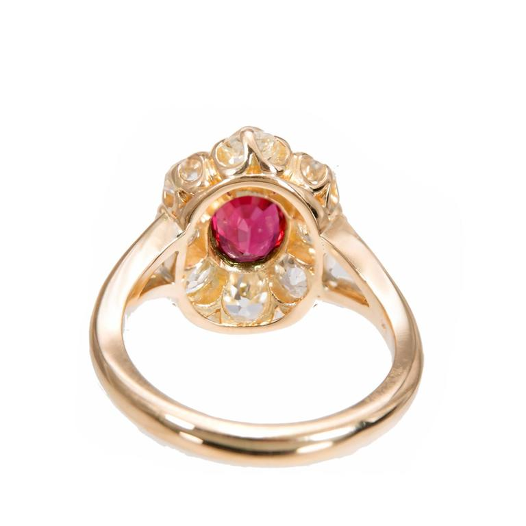 Natural no heat Ruby engagement ring. GIA certified center oval ruby with a halo of 8 old mine cut diamonds in a 18k yellow gold setting. Created in the Peter Suchy Workshop.    1 oval top gem red Ruby, approx. total weight 1.17cts, SI , natural no
