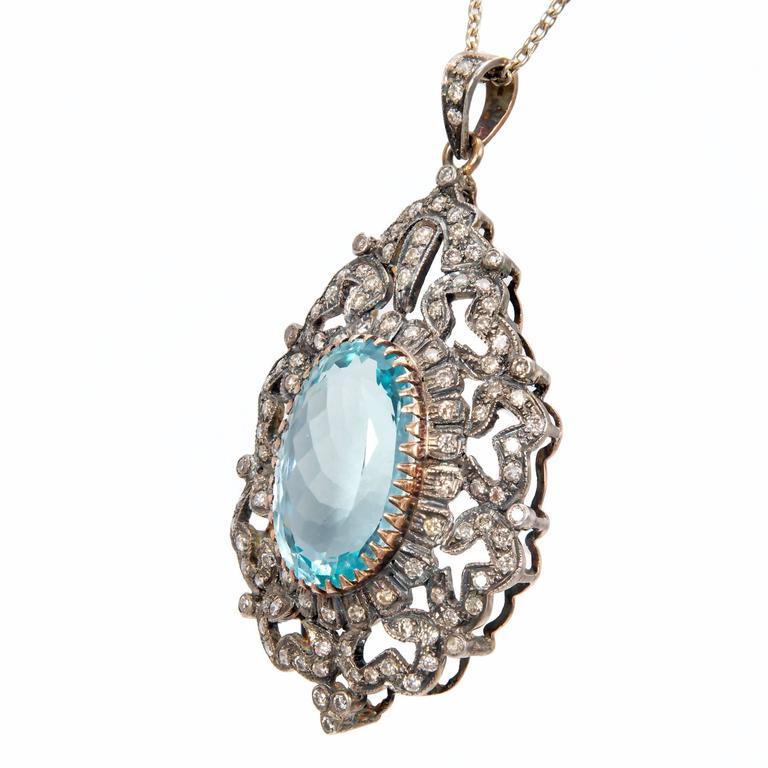 Handmade silver topped 14k yellow gold backed pendant. 18k yellow gold bezel. Genuine bright medium blue Aquamarine. 18k white gold chain all with natural patina. 