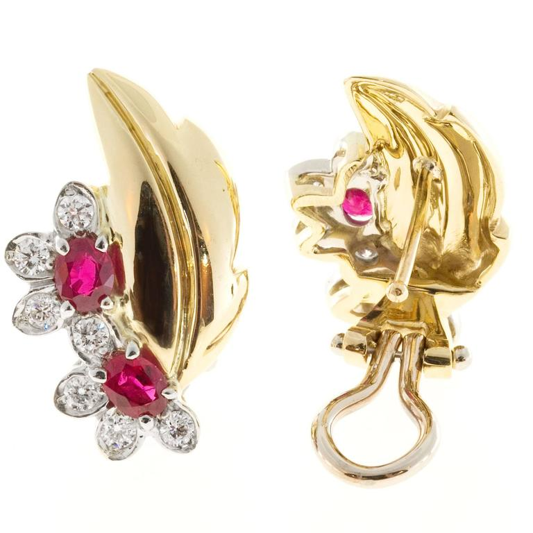 18k yellow gold clip post flower and leaf design earrings with fine bright Rubies and diamonds.