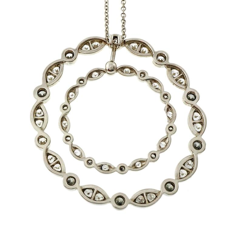 Authentic Tiffany & Co. large size swing circle platinum diamond pendant.  10 round diamonds, approx. total weight .40cts 20 round diamonds, approx. total weight .40cts 10 round diamonds, approx. total weight .10cts 10 round diamond¸ approx.