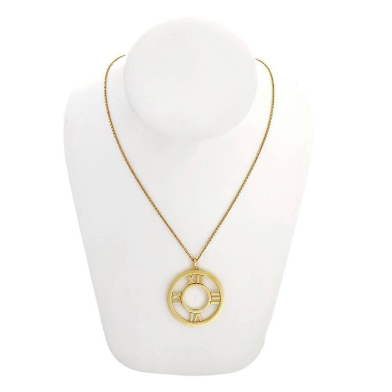 Tiffany and co gold round atlas pendant at 1stdibs tiffany co gold round atlas pendant in good condition for sale in stamford aloadofball Choice Image