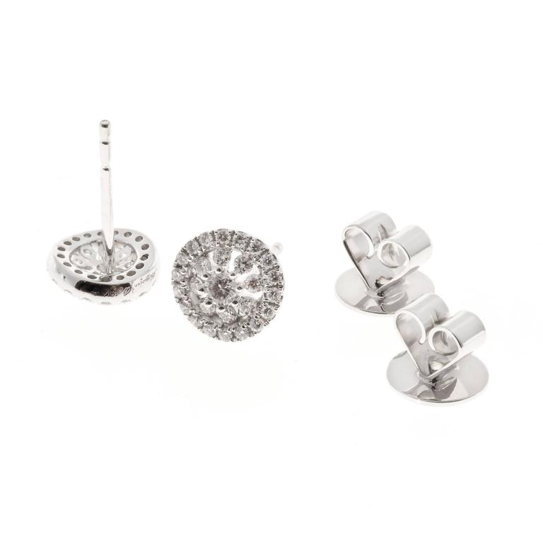 Memoire diamond Bouquets 18k white gold diamond stud halo earrings.  54 round diamonds, approx. total weight .41cts, F – G, VS 18k white gold Tested and stamped: 18k Hallmark: Mémbire B 18k .41ct 2.4 grams Top to bottom: 7.82mm or .31