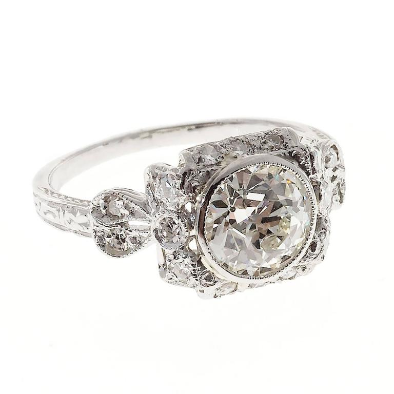 edwardian diamond platinum bow design engagement ring at