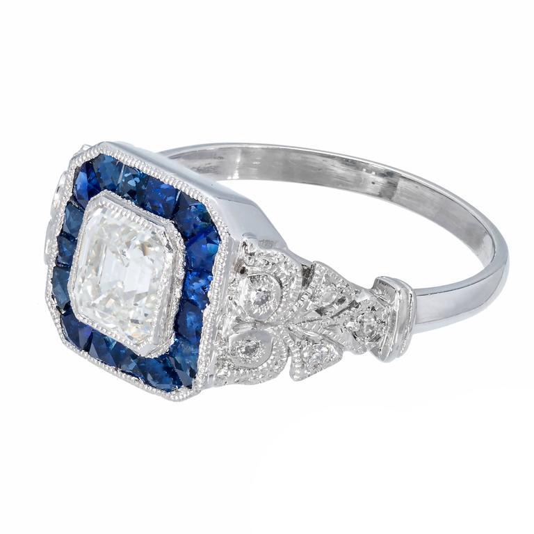 Diamond Calibre Sapphire Halo Platinum Engagement Ring For Sale at 1stdibs