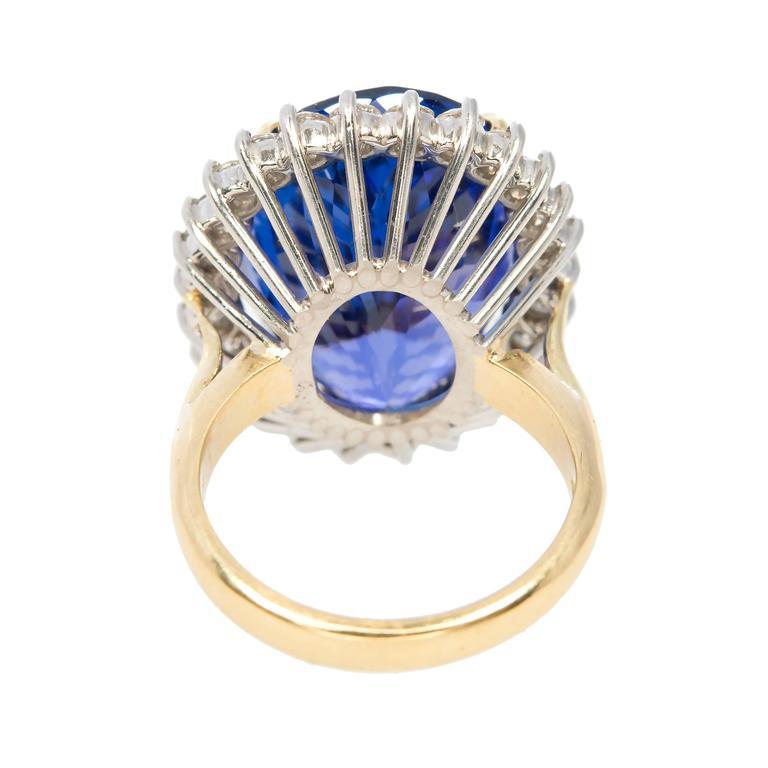 Women's Oval Tanzanite Diamond Gold Halo Ring For Sale