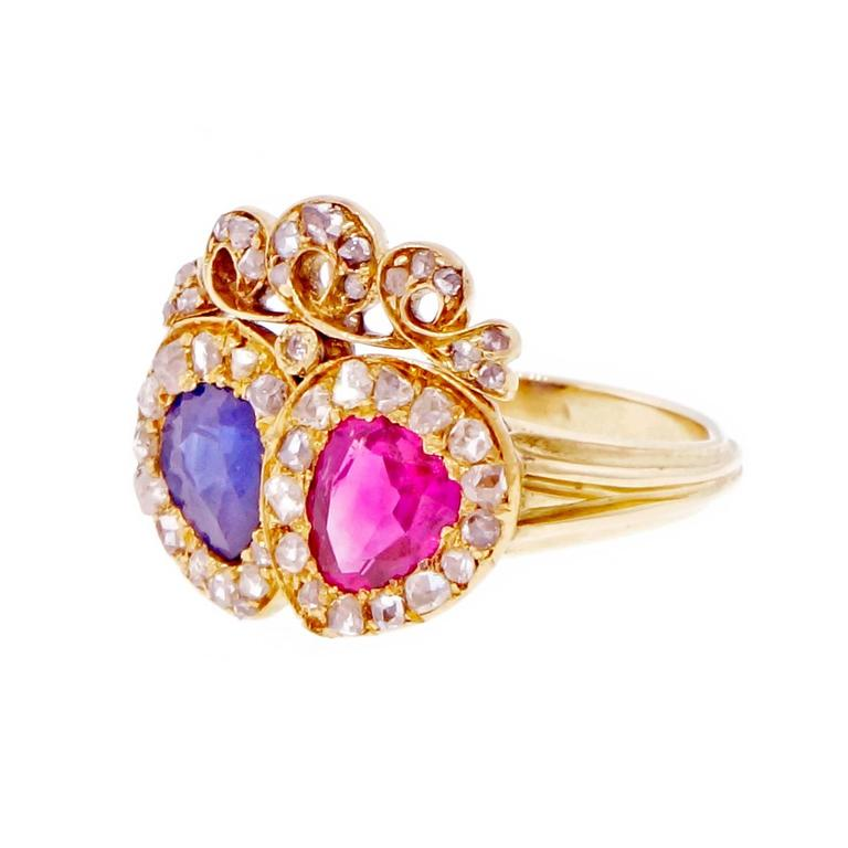 Victorian crown design ring circa 1870 set with one natural no heat Burma Ruby and one fine deep blue Sapphire, simple heat only. Both GIA certified. Surrounded by rose cut diamonds.  1 pear gem red Burma Ruby, approx. total weight .70cts,