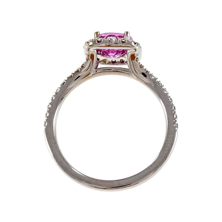 Rare bright hot pink natural no heat oval pink Sapphire engagement ring GIA certified in a custom made halo ring in 18k white gold from the Peter Suchy Workshop.  1 oval bright pink natural Sapphire, approx. total weight 1.58cts, no heat, GIA