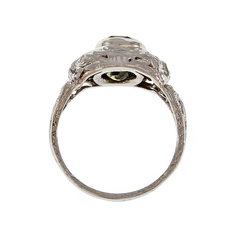 Antique Platinum engagement ring with a 2.89ct natural GIA certified Alexandrite that changes color from yellowish green to pinkish brown. Circa 1910.  1 cushion color change yellowish green to pinkish brown Alexandrite, approx. total weight