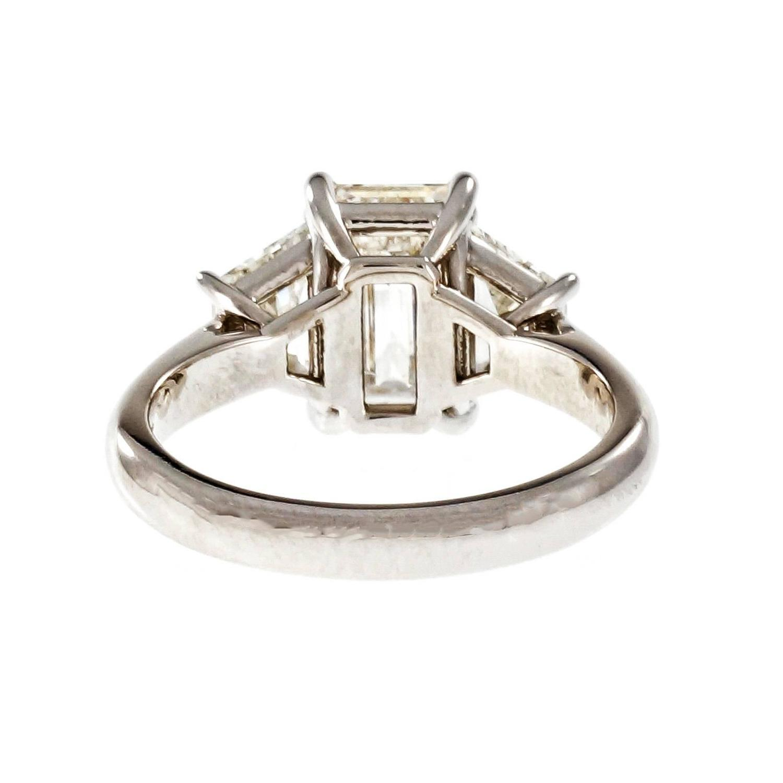Peter Suchy Emerald Cut Diamond Platinum Three Stone Engagement Ring For Sale