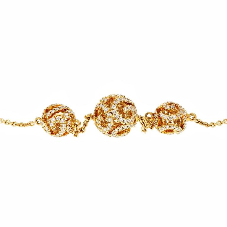 Designer JMP 18k rose gold necklace with 3 graduated Quartz rock crystal beads inside of diamond Pavé open work beads.  249 round diamonds, approx. total weight .90cts 3 round crystal beads 5.5 – 8mm 18k rose gold Tested and stamped: