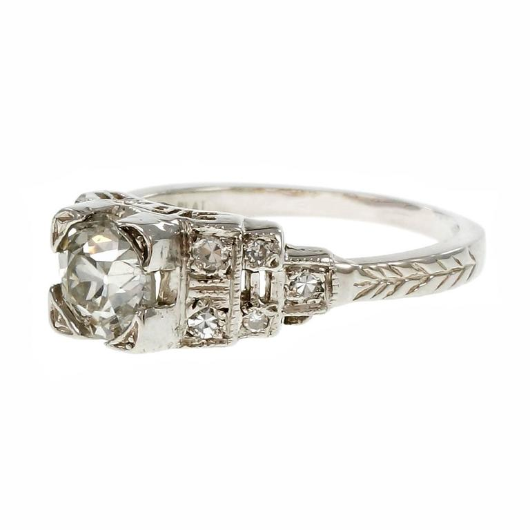 Art Deco 1930-1939 Diamond Platinum engagement ring with step design shoulders engraving and filigree work. Original old European cut bright sparkly diamonds. crt  1 old European cut diamond, approx. total weight .88cts, G – H, SI3,  10 round