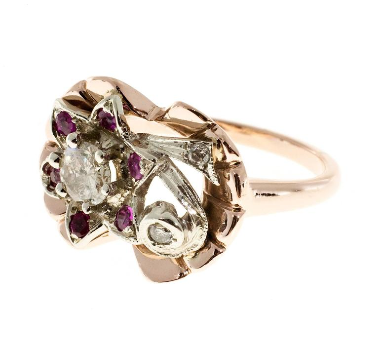 1930's rose and white gold diamond and Ruby cocktail flower design ring. design top.