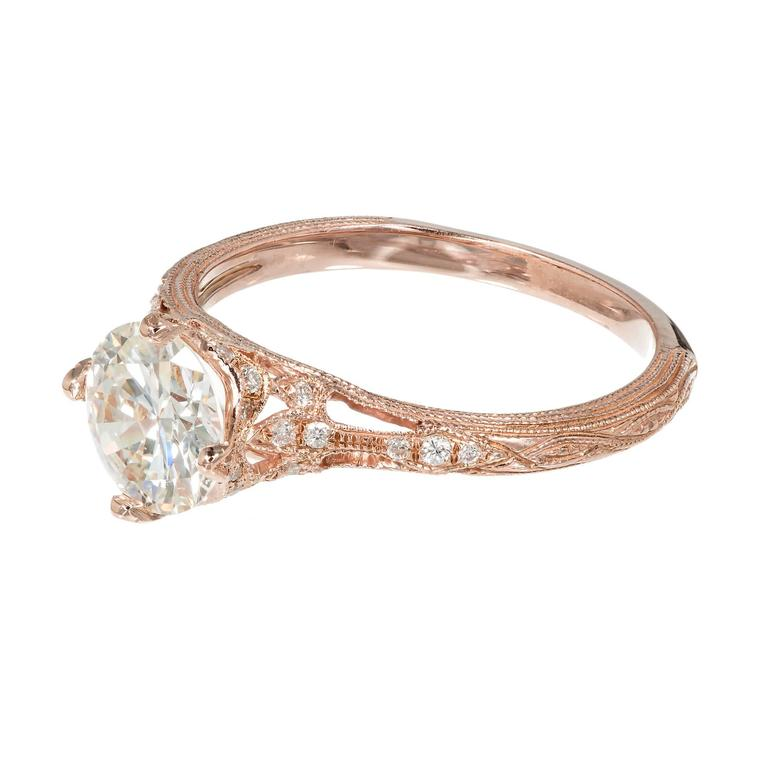 Transitional cut diamond engagement ring, set in a filigree, hand engraved rose gold setting, made by the Peter Suchy Workshop.  1 round diamond, approx. total weight 1.15cts, J, VS2, GIA certificate #2173866603 26 round diamonds, approx. total