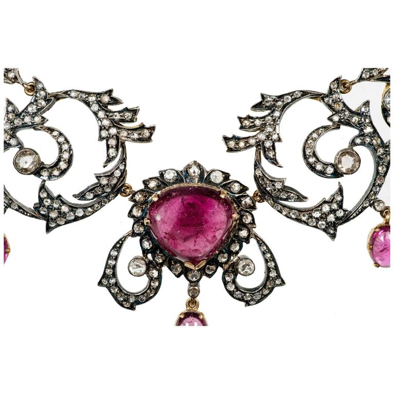 Circa 1890 pink tourmaline and diamond pendant necklace. Handmade 14k gold with silver tops. Set with rose cut diamonds. Natural patina.