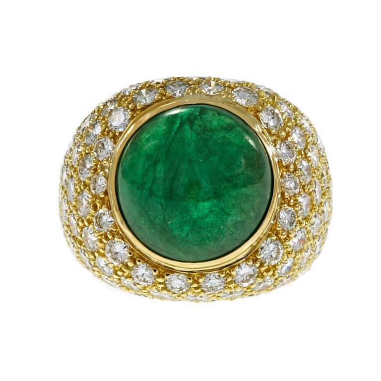 Green Emerald cabochon-cocktail dome ring circa 1960. GIA certified natural Beryl (Emerald) moderate clarity enhancement only. Bright green color with noticeable rolling light across the top. Moderate clarity enhancement only. Pavé set with 127