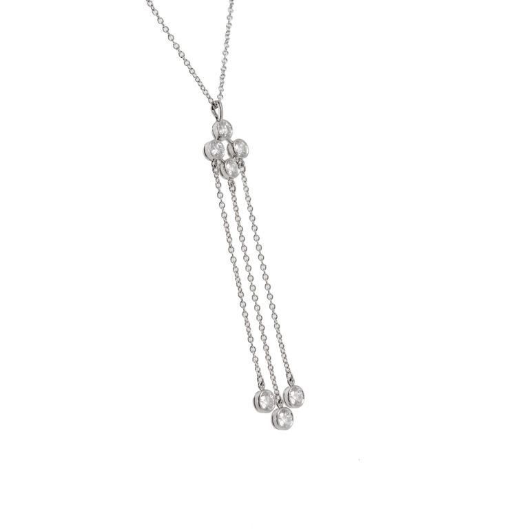 Tiffany & Co. Diamond Triple Dangle Platinum Necklace   7 round full cut diamonds approx. total  .66 cts F VS Platinum Tested: Platinum 4.0 grams Stamped: Pt 950 Total Length: 17 inch Width: 1.08mm Thickness / Depth: .89 Top to bottom: