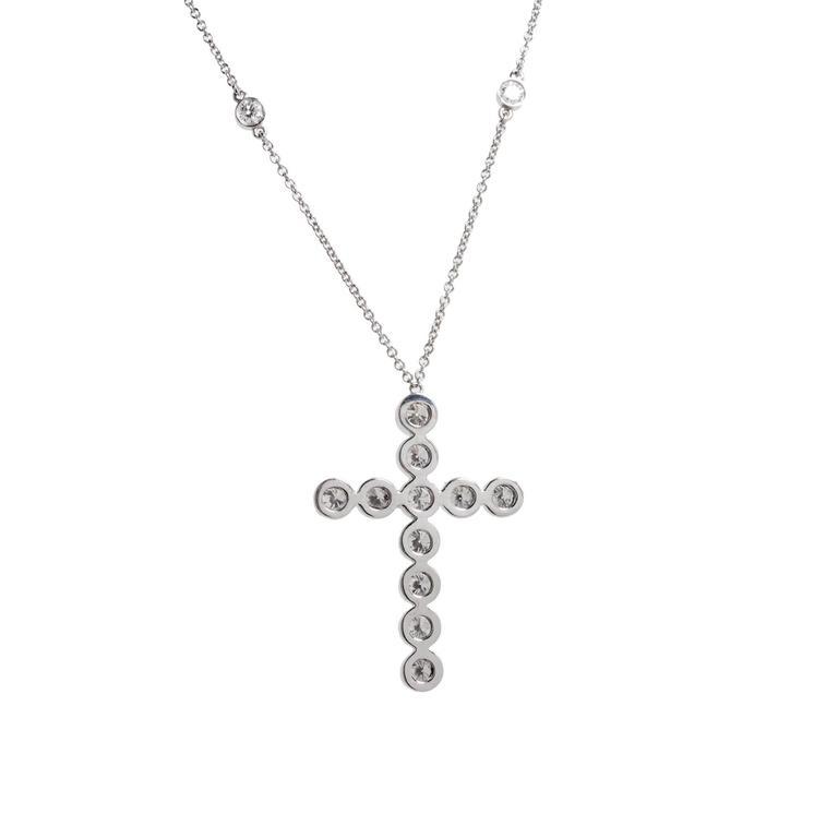 Authentic Tiffany & Co. Jazz Cross Diamond Pendant in Platinum  11 round diamonds F to G VS1 approx total weight 1.10cts 10 round diamonds F to G VS1 approx total weight .60 cts Platinum Stamped: Pt 950 Tested: Platinum Hallmark: Tiffany &