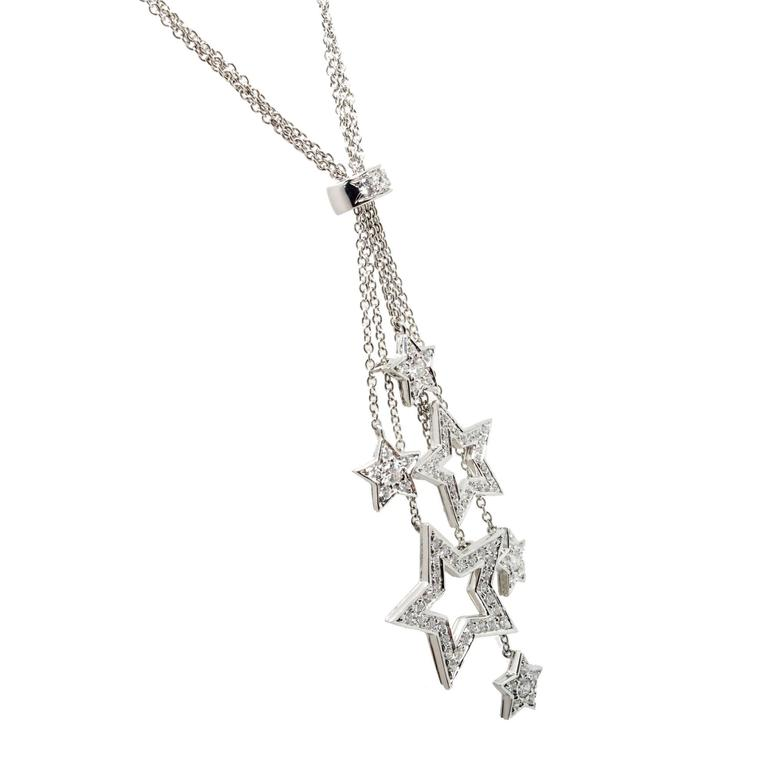Tiffany & Co Platinum Diamond multi star necklace pendant.   83 round diamonds full cut F VS approx. total weight .80 cts Stamped: Pt950 Hallmark: c Tiffany & Co Tested: Platinum Top to Bottom: 57.48mm or 2.26 inches Width: 19.96 mm or .78
