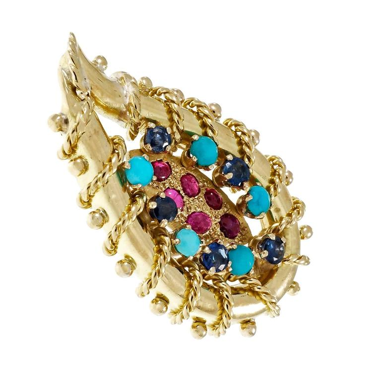1950's 18k yellow gold Ruby Turquoise Sapphire clip post earrings. Rope detail. Earrings and post tested 18k and 14k and Omega clips  12 oval cabochon red Rubies, approx. total weight .39cts, 2.32 – 2.52 x 1.69 – 1.88mm 10 round blue