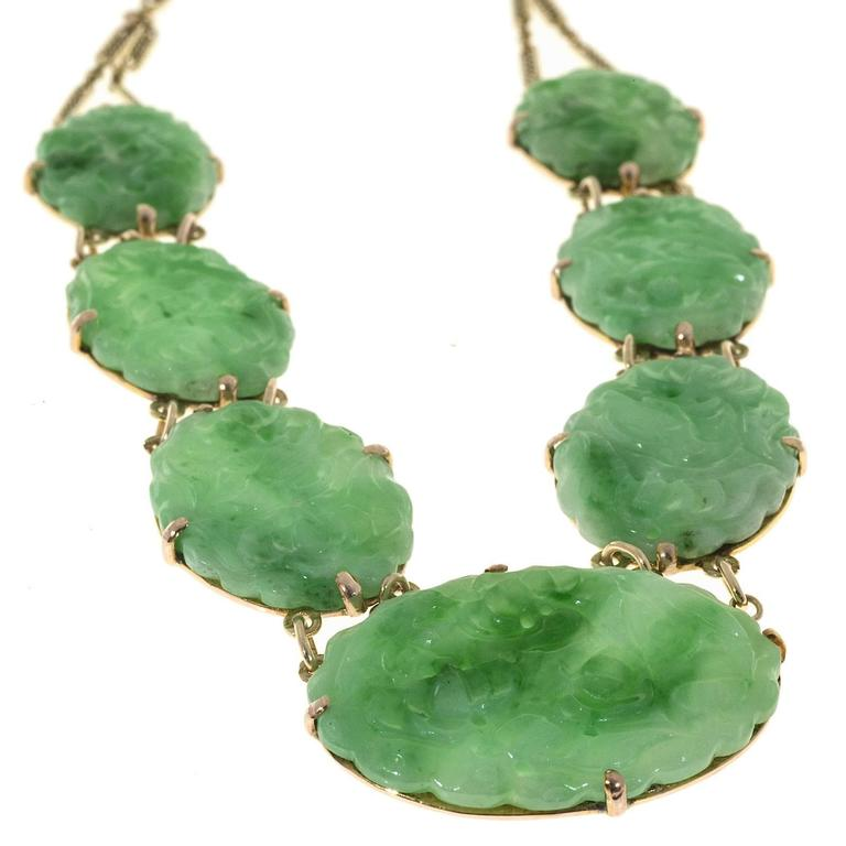Retro 1940's Art Deco hand made 7 stone all natural A grade natural Jadeite Jade necklace. Random tested by the GIA as natural color no enhancements. Hand made pink gold frames.      1 oval carved mottled green translucent Jadeite Jade, all