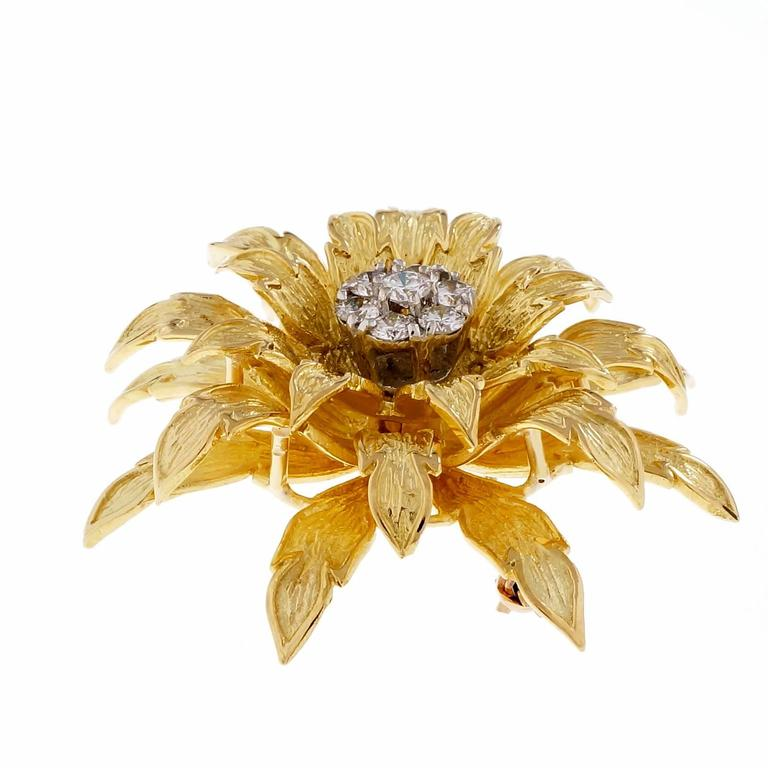Vintage 1960's 3-D Tiffany & Co textured diamond flower pin.  7 round full cut diamonds, approx. total weight .56cts, F, VS 18k yellow gold Tested and stamped: 18k Hallmark: Tiffany & Co 17.7 grams Top to bottom: 37mm or 1.5 inches Width: 37mm or