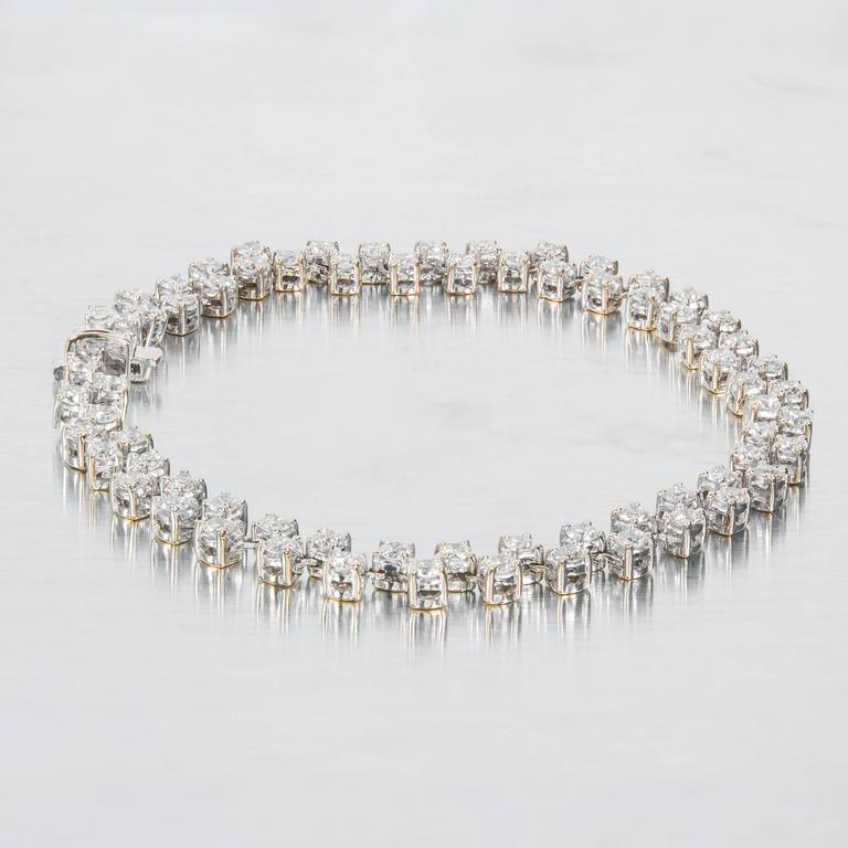 Two row white gold diamond bracelet set with bright full cut diamonds. Hidden built in catch with underside safety.  72 round diamonds H-I VS-SI approximately 3.20 carats 18k White Gold Tested: 18k 12.9 Grams Bracelet/Chain: 7 inch Width: