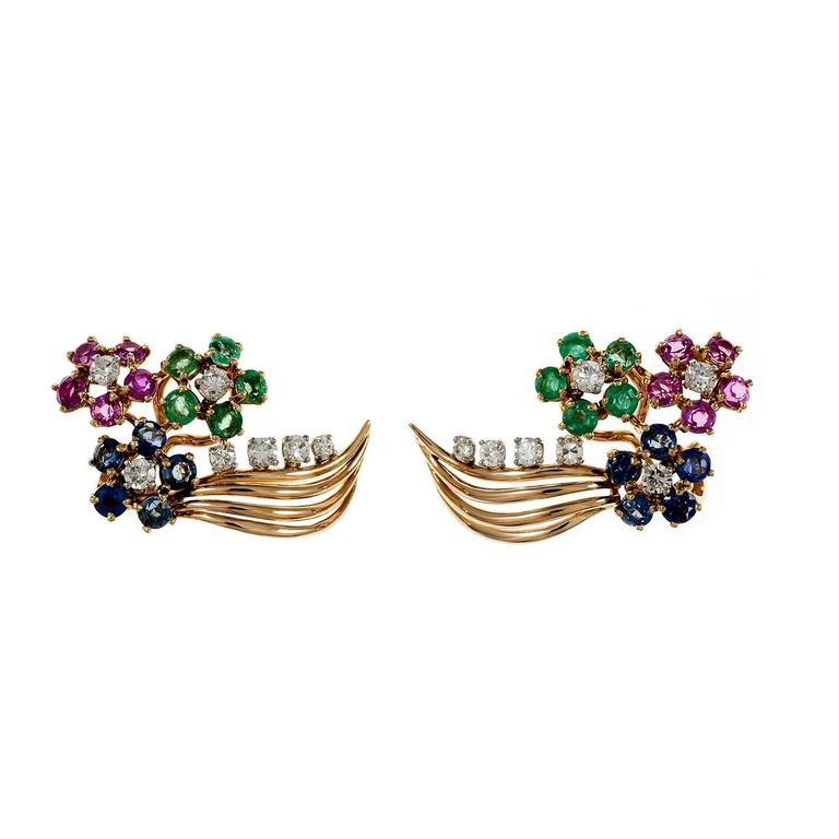 1940-1950 vintage clip post flower design earrings in 14k gold with genuine Emeralds, Rubies, Sapphires and Diamonds.  14 round full cut Diamonds, approx. total weight .60cts, H – I, VS 10 pinkish red genuine Rubies, approx. total weight 1.15cts,