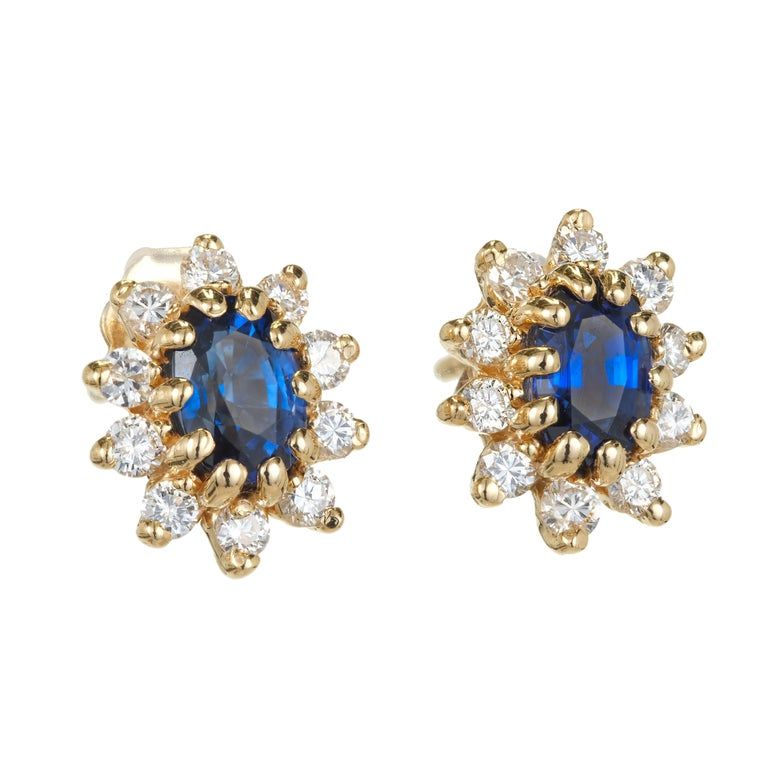 Oval fine blue oval Sapphire cluster diamond halo earrings in 14k yellow gold.  2 oval blue Sapphires, approx. total weight 1.20cts, 6.16 x 4.3 x 2.89mm 20 round full cut Diamonds, approx. total weight .40cts, G, VS 14k yellow gold Tested and