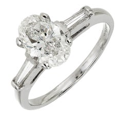 EGL Certified Oval Diamond Three-Stone Platinum Engagement Ring