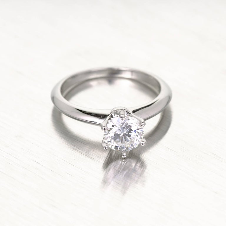 Tiffany & Co diamond solitaire engagement ring in a platinum setting. 1980-1990 stamped authentic Tiffany Platinum engagement ring.  GIA certified diamond. The diamond was removed for GIA certificate # testing and reset.   1 round Ideal cut diamond,