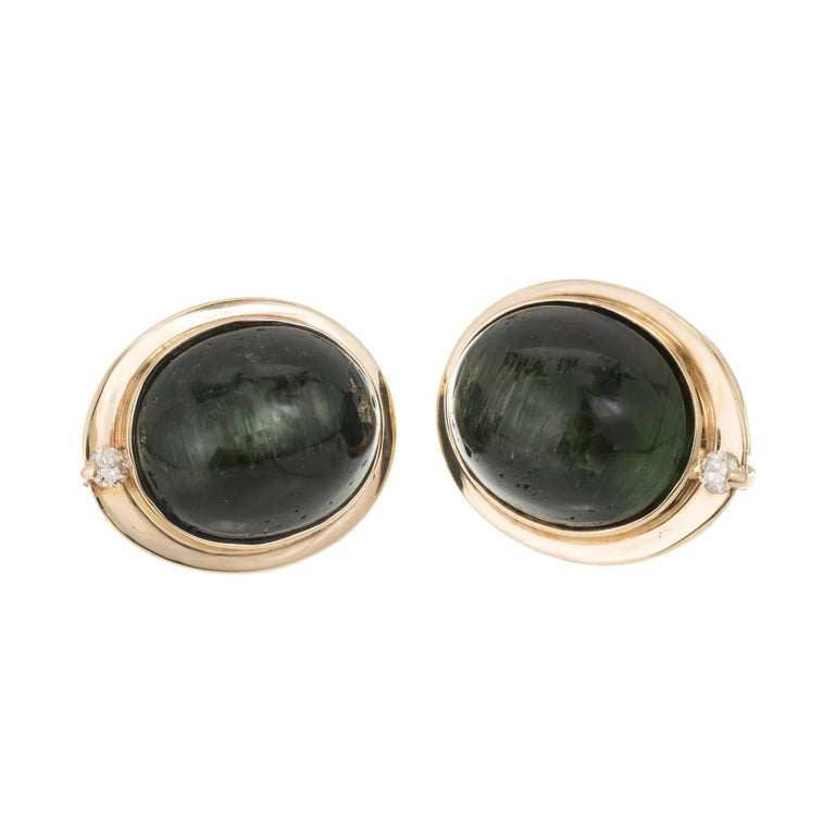 Natural untreated green cats eye Tourmaline 14k yellow gold diamond clip post earrings  Two full cut diamonds, approx. total weight .06cts, G, VS2. AGL certificate # CS49501AB Two matched natural untreated no heat no enhancements 14 x 11mm dark