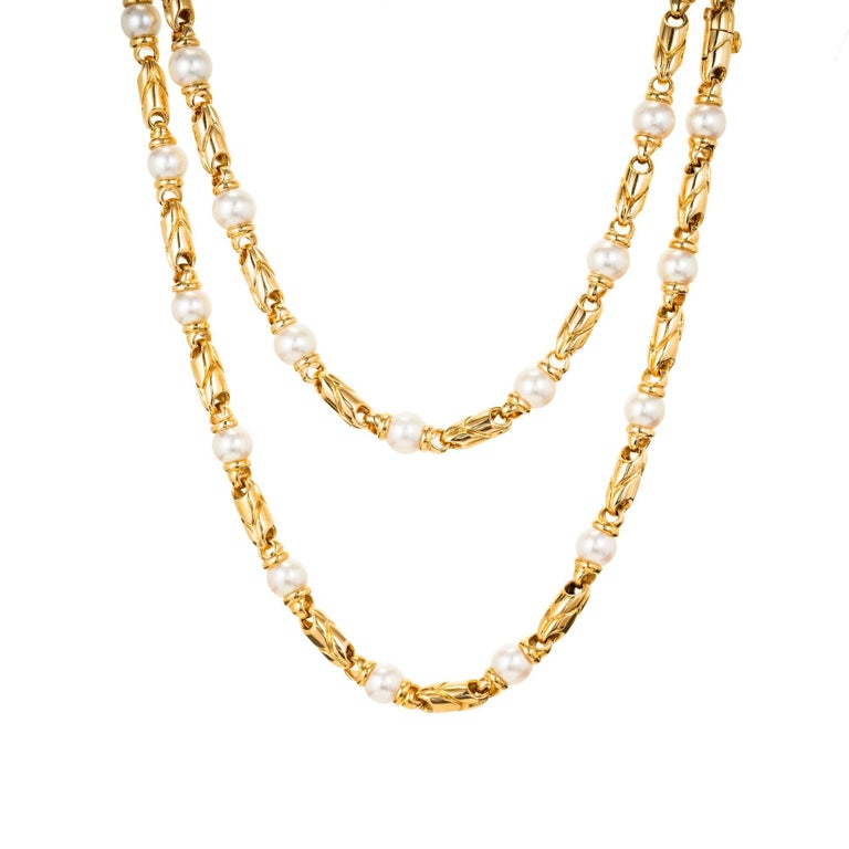 Bvlgari 18 yellow gold Passo Doppio Pearl Necklace. Two separate necklaces at 17.5 inches long each, allows this matched set to be worn single or double at 17.5 inches or clasped together at 35 inches. The clasps are built into the connecting links