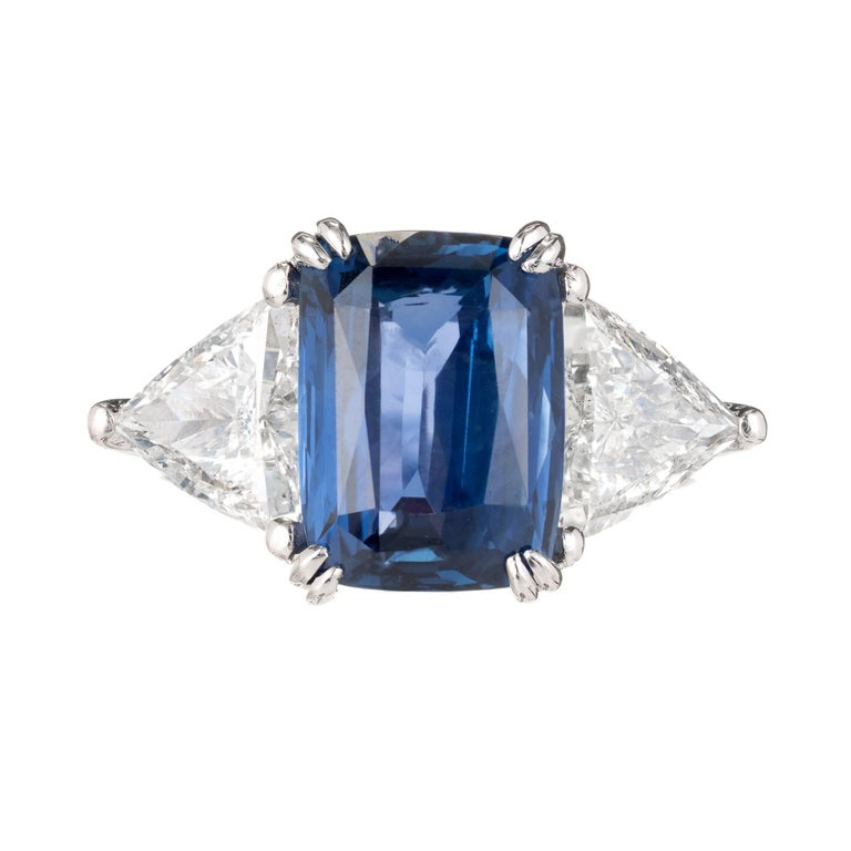 Peter Suchy cushion cut rectangle Sapphire and diamond three-stone engagement ring. GIA certified sapphire all-natural no heat and no enhancements with 2 trilliant cut side diamonds in a platinum setting. The ring was designed and made in the Peter