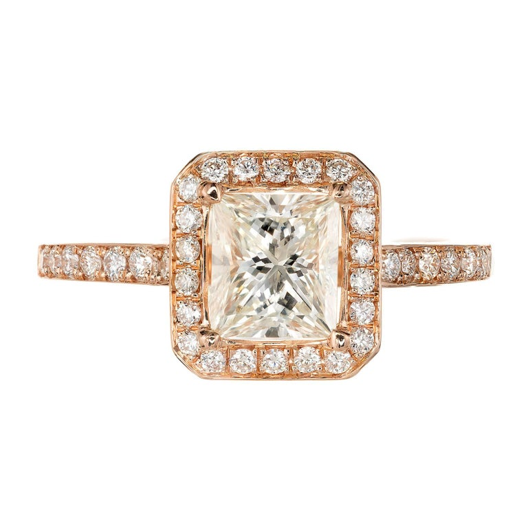 1.00ct Princess cut diamond halo 18k rose gold engagement ring from Peter Suchy Designs. A wedding band will fit flush next the shank.   1 Princess cut diamond, approx. total weight 1.00cts, M, VS2, face up I – J, GIA certificate #2165818975  36