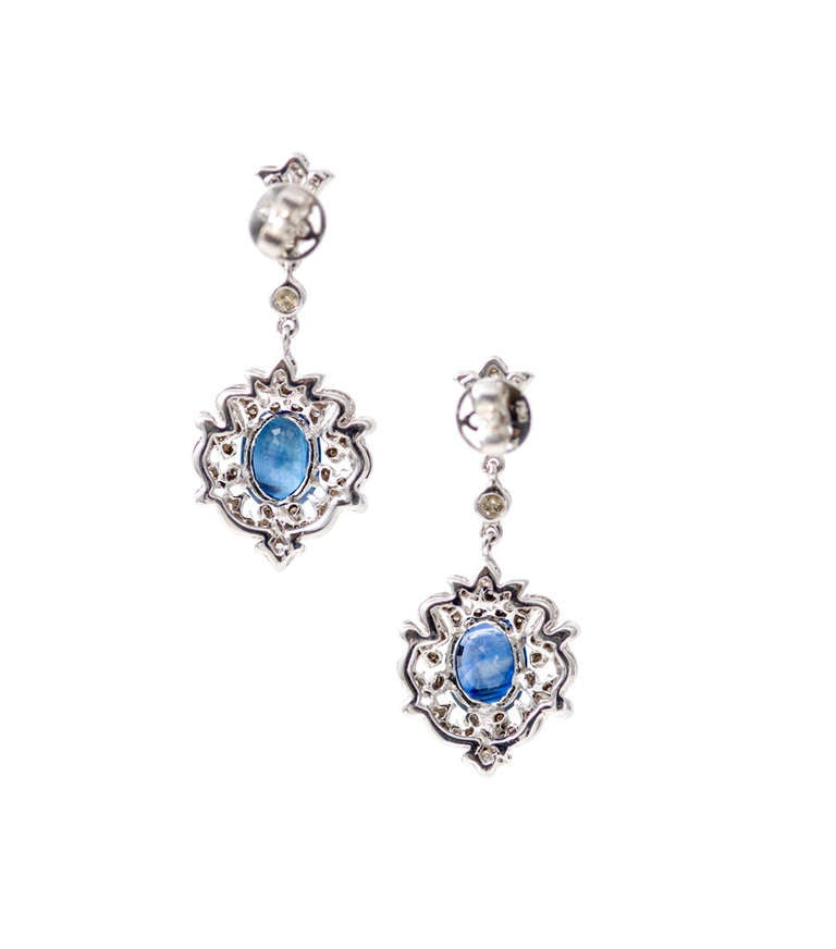 1940's filigree open work dangle earrings with nice white full cut diamonds  and bright Royal blue Sapphires. GIA certified in the settings. Natural corundum, simple heat only.