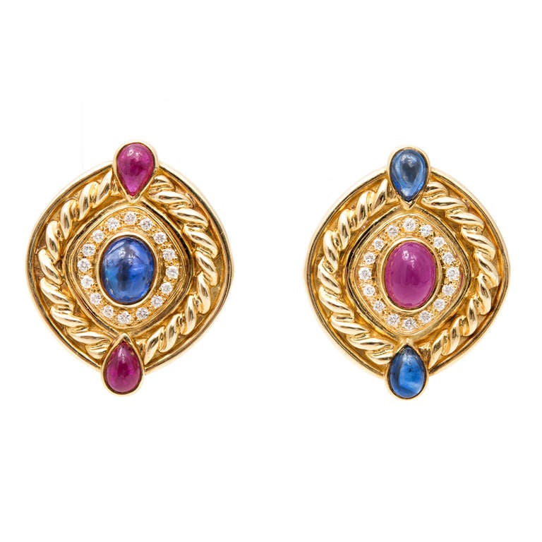 Circa 1950's Heavy swilr 18k yellow gold clip post earrings. Cabochon ruby and sapphire with full cut diamonds.   1 oval cabochon sapphire 9x7mm  1 oval cabochon ruby 9x7mm  2 pear cabochon ruby 7x5 2 pear cabochon sapphire 7x5 Sapphire approx