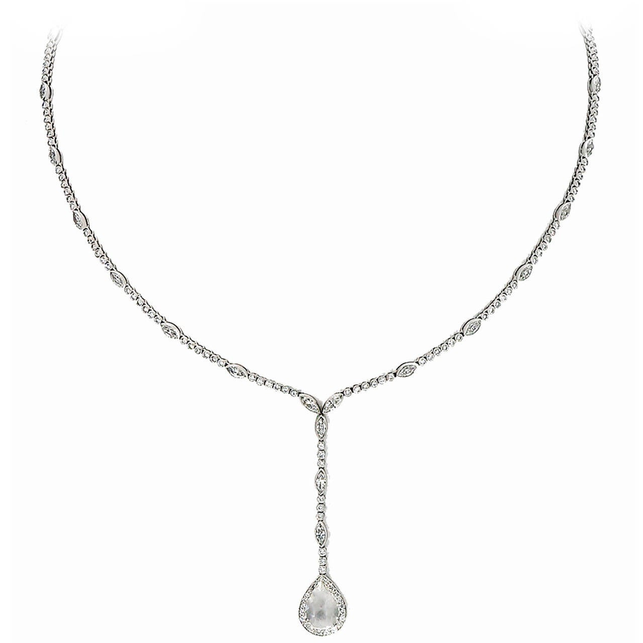 Solid Platinum handmade hinged link necklace with over 200 diamonds of fine white F plus color and VS plus clarity hand set in Milgrain bead set tubes or bezels with a fine oval low prong set, rose cut catch and a pear shaped rose cut halo at the