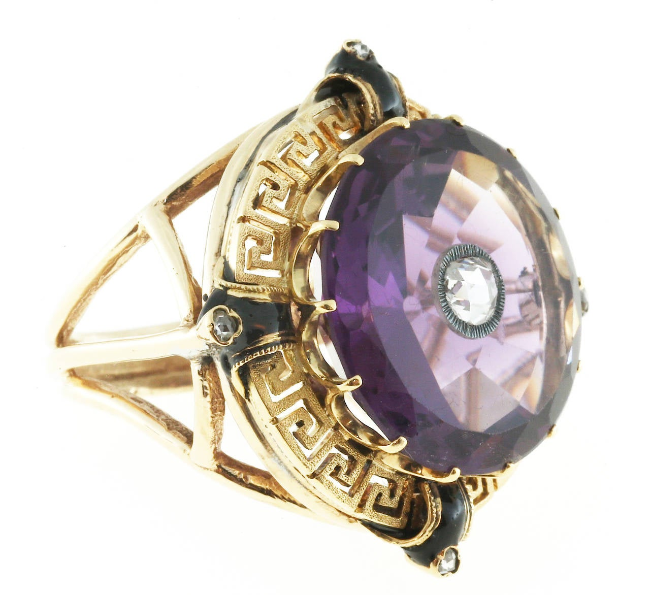 Handmade ring circa 1930-1940 with genuine flat top round Amethyst with faceted crown and pavilion. The center of the Amethyst has a silver tube and is set with a rose cut diamond. Black enamel accents are at North, South, East and West and a small