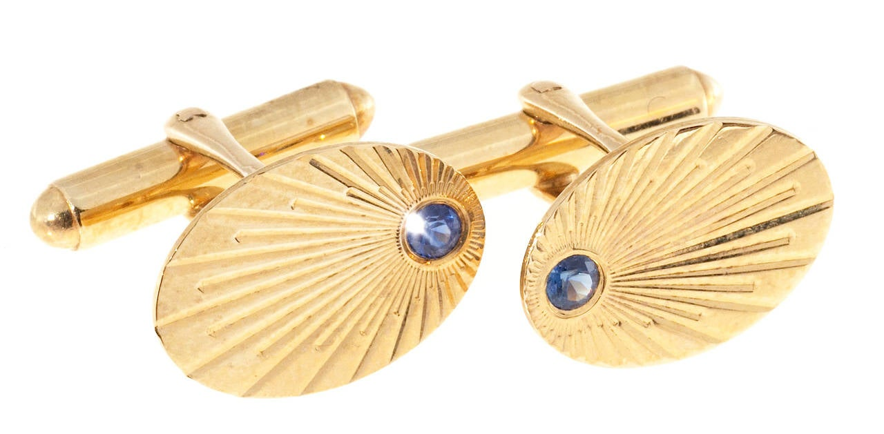 Larter & Sons 1940-1950 oval machined cufflinks with certified natural no heat Sapphires. Extra fine color.  2 natural no heat no enhancements blue natural Sapphires, approx. total weight .30cts. GIA certificate #2145741708 14k Yellow